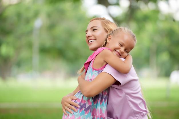 embracing mom and girl