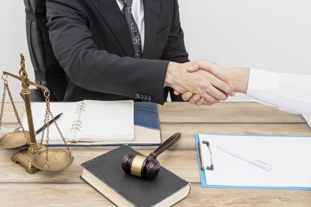 Shaking hands lawyers